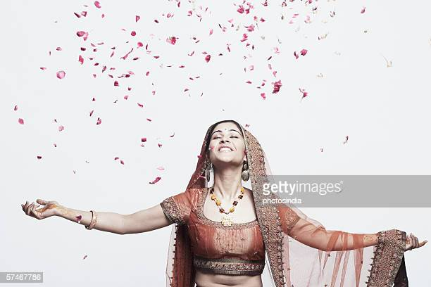 rose petals falling on a young woman - blütenblatt stock-fotos und bilder