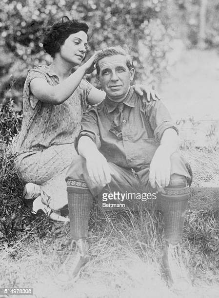 Rose Ponzi stroking her husband Charles Ponzi's hair while at their camp Charles Ponzi was a scam artist who ran false investment firm
