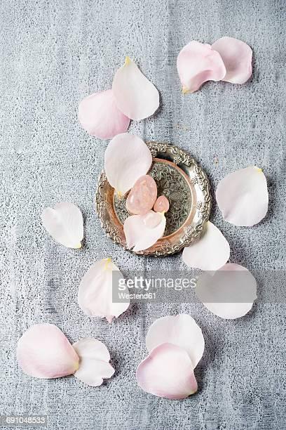 Rose quartz with rose petals