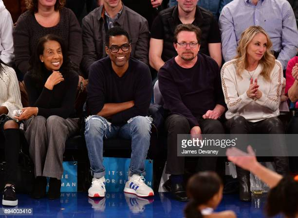 Rose Rock Chris Rock Michael J Fox and Tracy Pollan attend the Oklahoma City Thunder Vs New York Knicks game at Madison Square Garden on December 16...