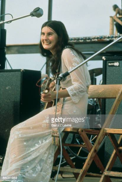 Rose Simpson of the Incredible String Band smiles while performing onstage at the Woodstock Music and Arts Fair in Bethel New York August 15 17 1969