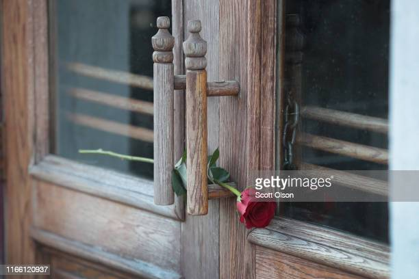 A rose sits in the door at the entrance of Ned Peppers bar in the Oregon District before the start of a memorial service to recognize the victims of...