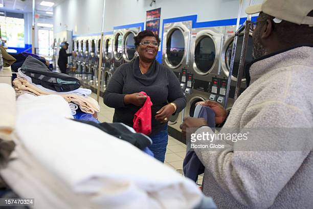 Rose Smith folds clean laundry with her husband Courtney Smith at Laundry King in Grove Hall in Boston Mass on Tuesday morning October 23 2012 When...