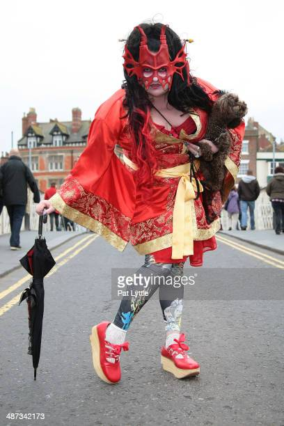 Rose Thorne wears a mask by Ancestor Leather craft a dress made in China Japanese Dolly Rocker shoes with socks and leggings during the Whitby Goth...