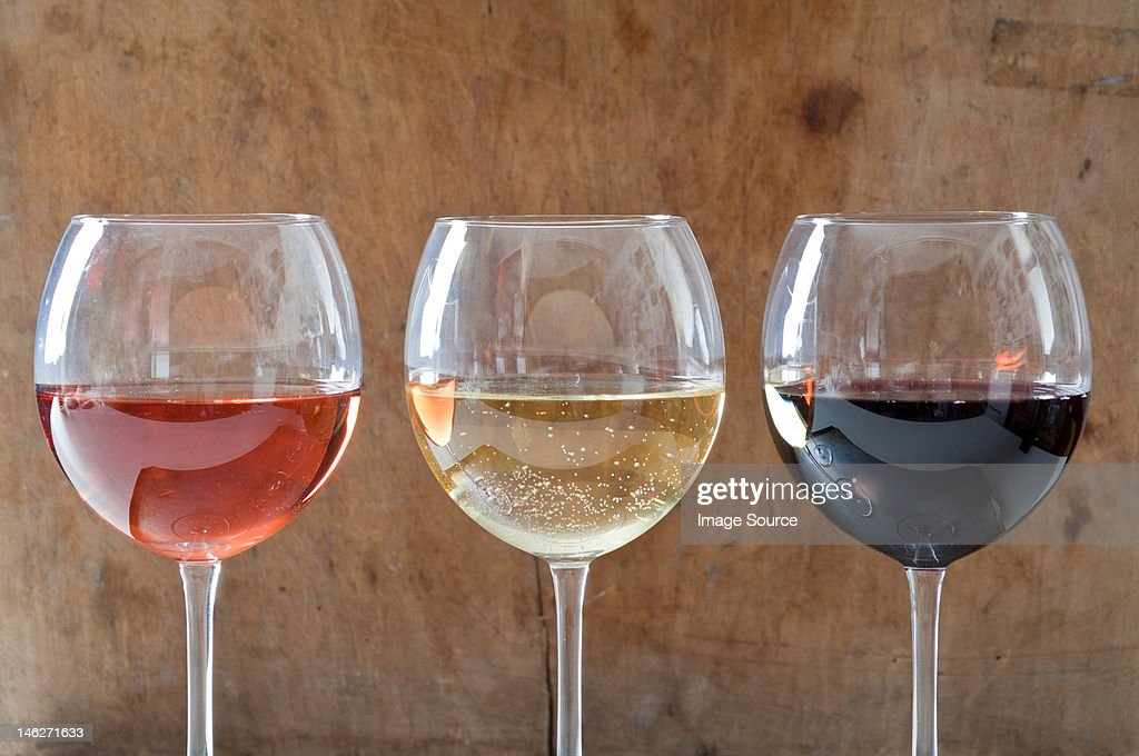 Rose, white and red wines in glasses : Stock Photo