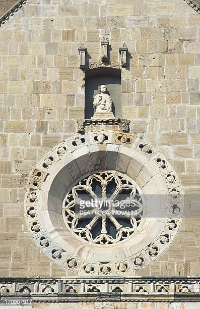 Rose window on the facade, Cathedral of St Mary of the Assumption, Orbetello, Tuscany, Italy.