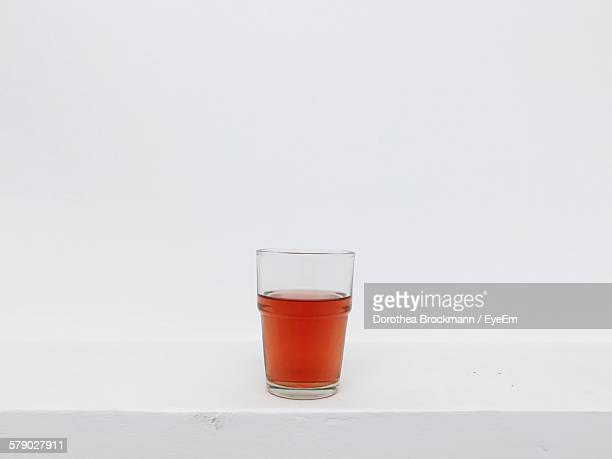 Rose Wine In Glass Against White Background