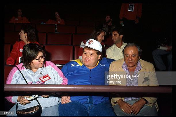 Roseanne Barr Louie Anderson and Bill Dana sit together at the Comic Relief benefit November 14 1987 in Los Angeles CA Comic Relief founded by...
