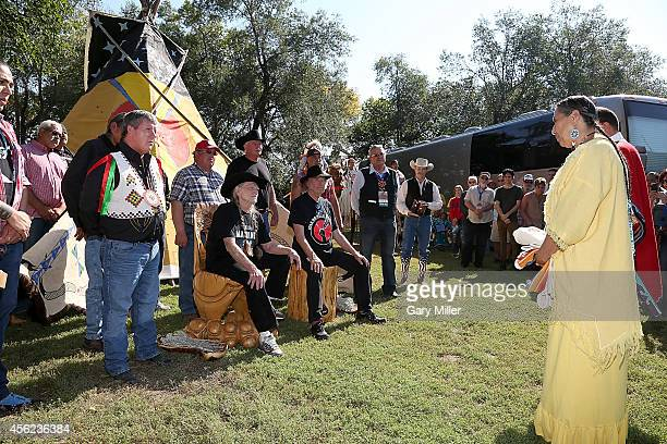 Rosebud Sioux Tribal President Cyril Scott Willie Nelson Neil Young Ogalala Sioux Tribal President Bryan Brewer listen as Casey Camp speaks during a...