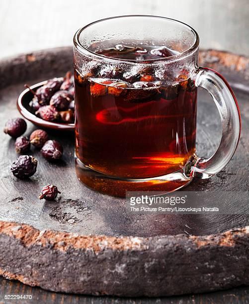 Rosehip tea on dark background