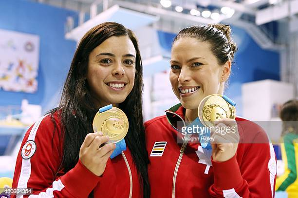 Roseline Filion and Meaghan Benfeito of Canada celebrate winning Gold in the Women's 10m Synchro Final during the Toronto 2015 Pan Am Games at the...