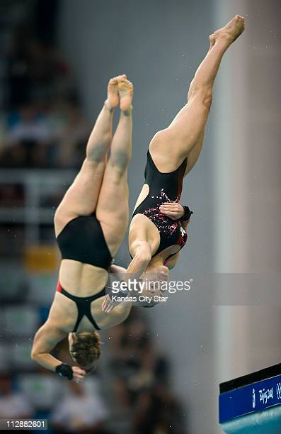 Roseline Filion front and Meaghan Benfeito of Canda compete in the 10meter Platform Synchronized diving final on Tuesday August 12 in the Games of...