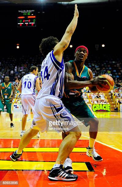 Rosell Ellis of the Crocodiless looks to make a basket despite the defence of Matthew Knight of the Spirit during the round 12 NBL match between the...