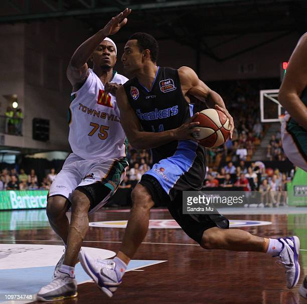 Rosell Ellis of the Crocs defends Mika Vukona of the Breakers during the round 21 NBL match between the New Zealand Breakers and the Townsville...