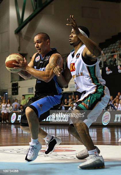 Rosell Ellis of the Crocs holds his defence against Paul Henare of the Breakers during the round 21 NBL match between the New Zealand Breakers and...
