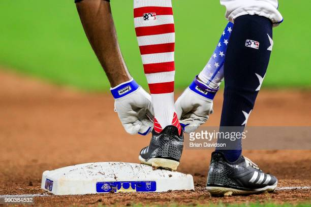 Rosell Herrera of the Kansas City Royals adjust his shoes during the sixth inning against the Cleveland Indians at Kauffman Stadium on July 2 2018 in...