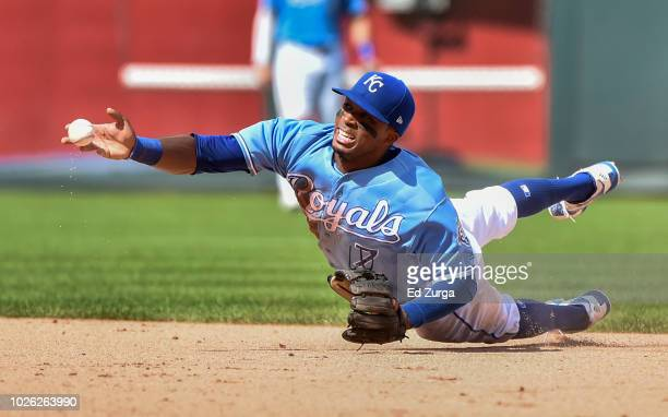 Rosell Herrera of the Kansas City Royals tosses the ball to Alcides Escobar to get the force on Chris Davis of the Baltimore Orioles in the seventh...