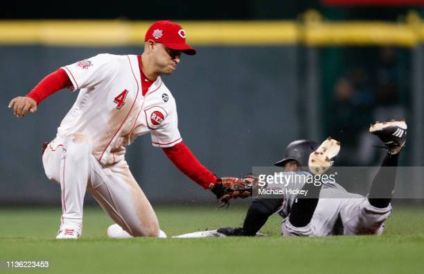 Rosell Herrera of the Miami Marlins slides into second base as Jose Iglesias of the Cincinnati Reds applies to the tag during the seventh inning at...