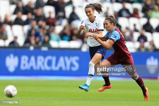 Rosella Ayane of Tottenham Hotspur and Laura Vetterlein of West Ham United compete for the ball during the Barclays FA Women's Super League match...