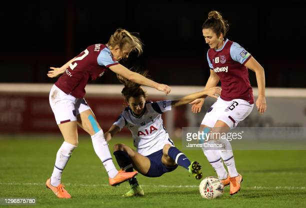 Rosella Ayane of Tottenham Hotspur is challenged by Kate Longhurst and Laura Vetterlein of West Ham United during the Barclays FA Women's Super...