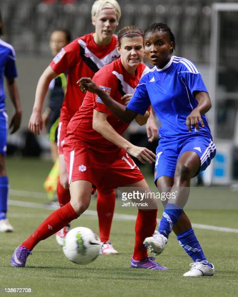 Roselord Borgella of Haiti and Christine Sinclair of Canada battle for the ball at the 2012 CONCACAF Women's Olympic Qualifying Tournament at BC...