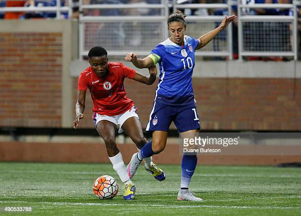 Roselord Borgella of Haiti steals the ball from Carli Lloyd of the United States during the second half of the US Women's 2015 World Cup victory tour...