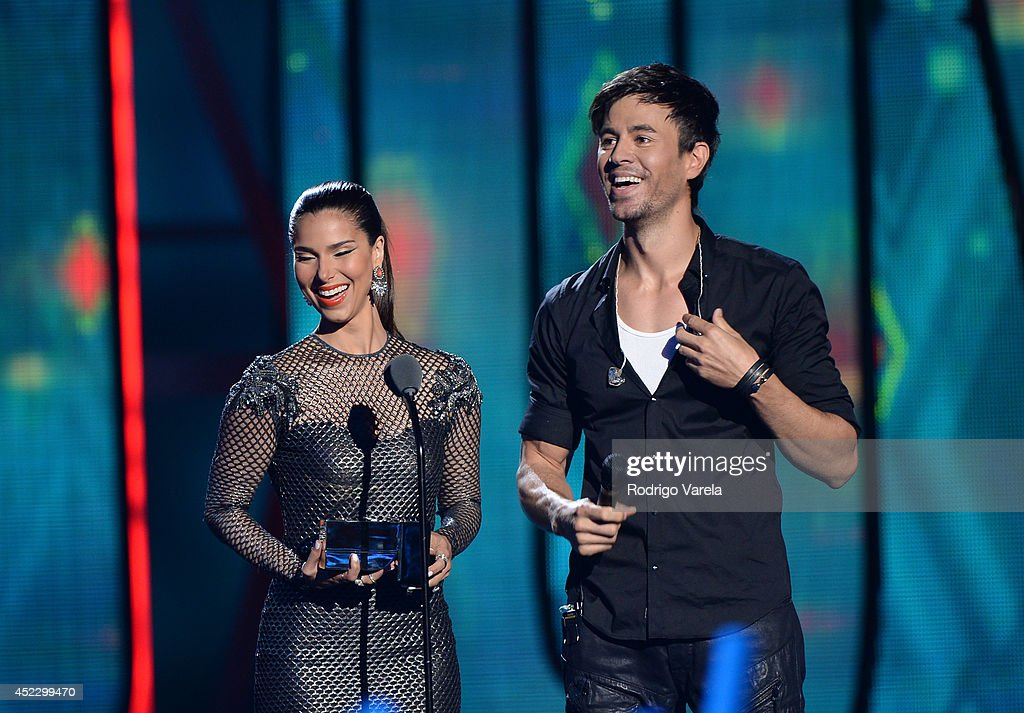 Roselyn Sanchez and Enrique Iglesias performs onstage during the Premios Juventud 2014 at The BankUnited Center on July 17, 2014 in Coral Gables, Florida.