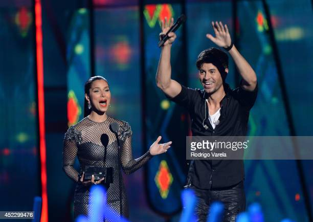 Roselyn Sanchez and Enrique Iglesias performs onstage during the Premios Juventud 2014 at The BankUnited Center on July 17, 2014 in Coral Gables,...