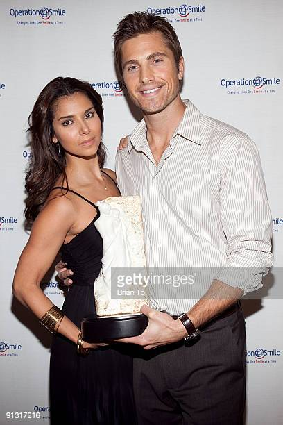 Roselyn Sanchez and Eric Winter attend 8th Annual Operation Smile PreGala KickOff Reception at Lladro Boutique on October 1 2009 in Beverly Hills...