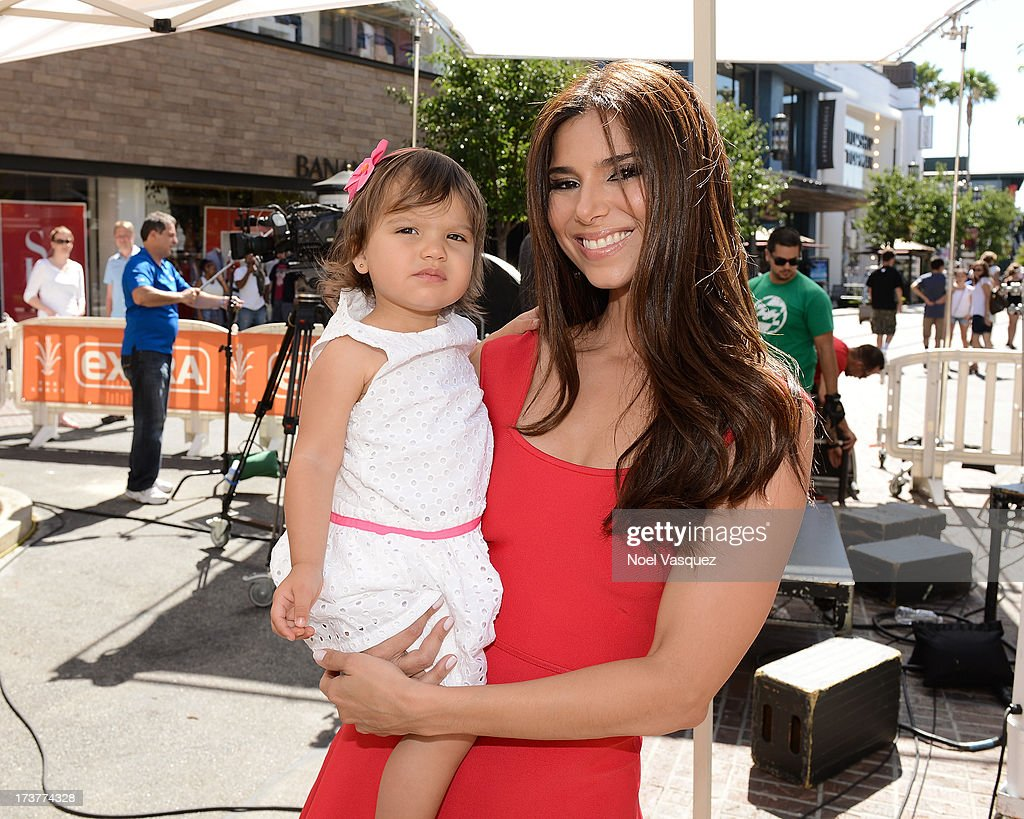 Roselyn Sanchez (R) and her daughter Sebella Rose Winter visit 'Extra' at The Grove on July 17, 2013 in Los Angeles, California.