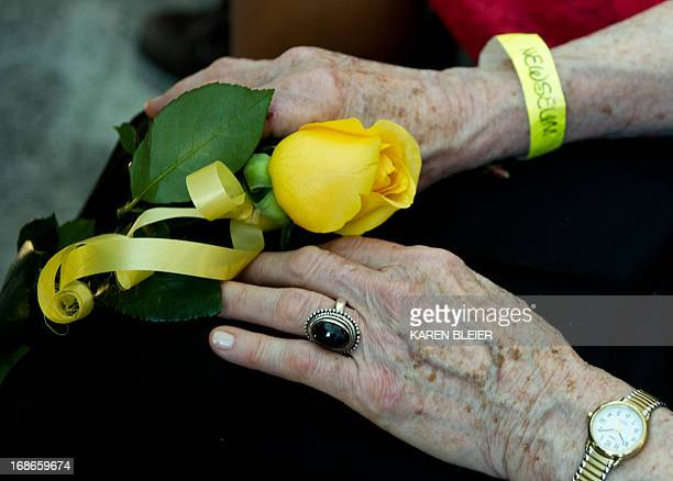 Rosemarie Colvin mother of journalist Marie Colvin who was killed in Syria holds a rose for placement at the Newseum's Journalists Memorial during...