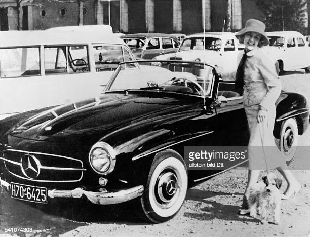 Rosemarie Nitribitt Rosemarie Nitribitt *19331957 Prostitute Germany 1957 murdered portraet standing by her Mercedes with poodle 1950ies