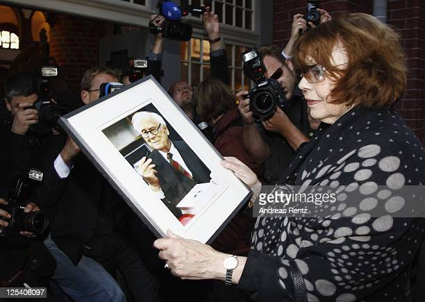 RoseMarie von Buelow widow of German comedian Vicco von Buelow looks on a picture of her husband prior to the funeral service at the St Gotthardt...