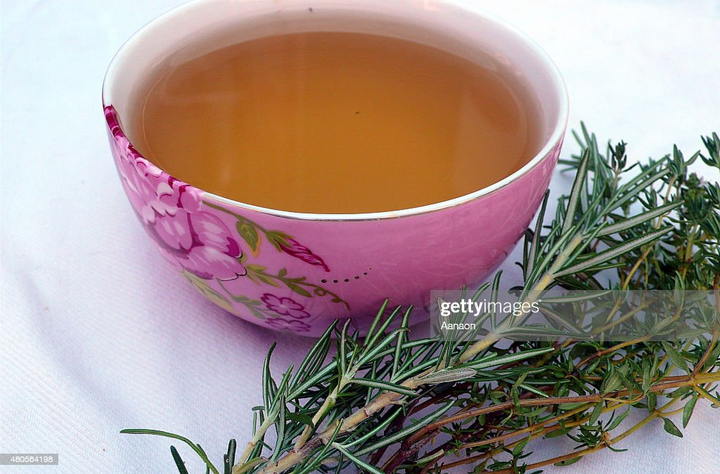 rosemary and thyme herb tea on table : Stock Photo