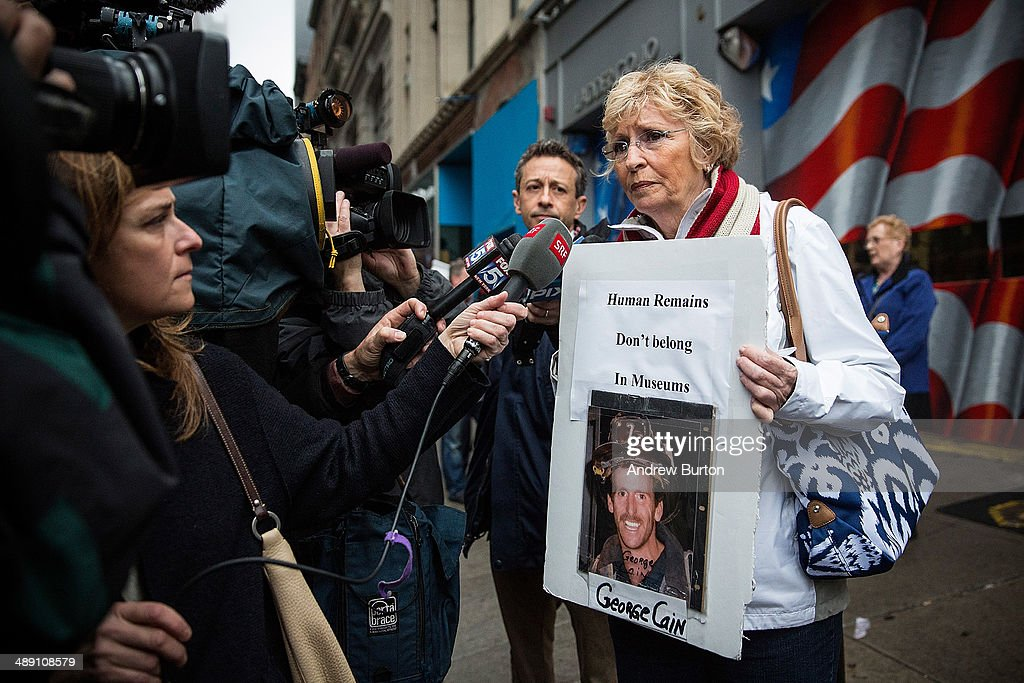 Rosemary Cain (R), mother of firefighter George Cain, a victim of the September 11, 2001 attack, and other victim's family members protest the decision by city officials to keep unidentified human remains of the 9-11 victims at the 9-11 Museum at the World Trade Center site, on May 10, 2014 in New York City. The decision by city officials to keep the remains at the museum until they are able to be identified has drawn both support and criticism by families of victims. The remains were moved early this morning from the medical examiner's repository to the 9-11 Museum.