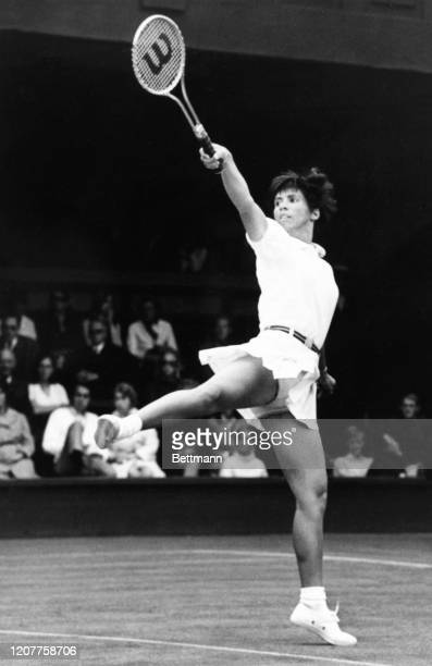 Rosemary Casals lifts her right leg high as she makes a return to Valerie Ziegenfuss during their match in the Wimbledon tennis championship.