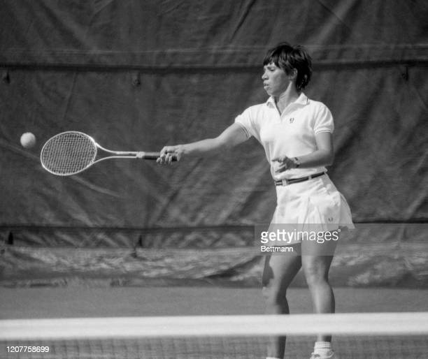 Rosemary Casals slamming a strong forehand during the women's finals of the U.S. Open Tennis Championships. Rosemary Casals shows why her opponent in...