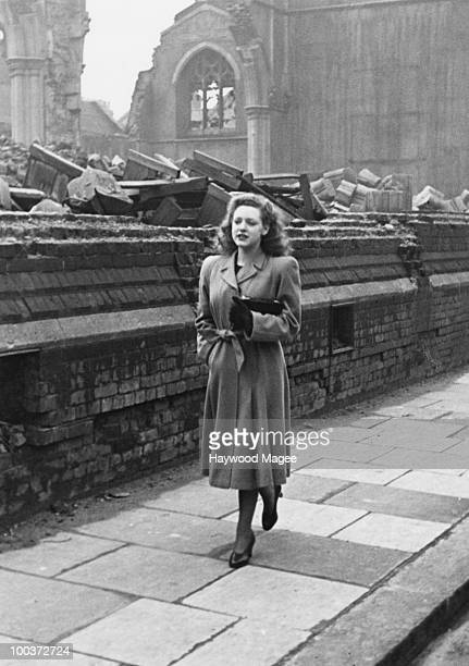 Rosemary Davidson walks home past a bombdamaged church in Fulham London April 1942 Earlier in the day she had played the role of Britannia in a...