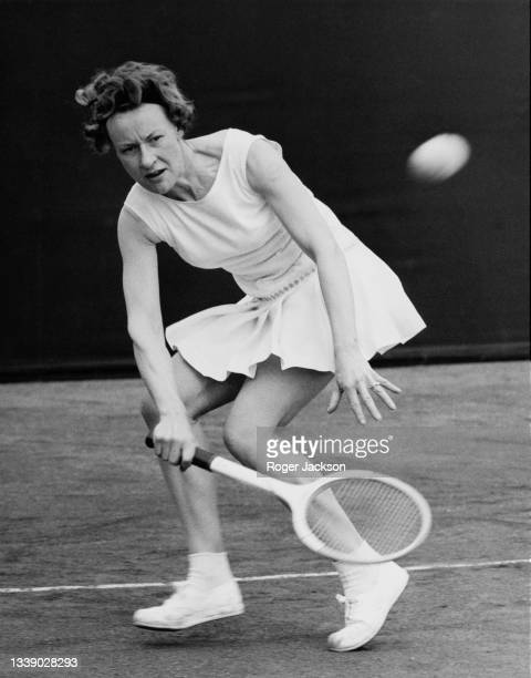 Rosemary Deloford of Great Britain looks at the tennis ball while playing a forehand return to Sally Holdsworth during their Women's Singles match at...