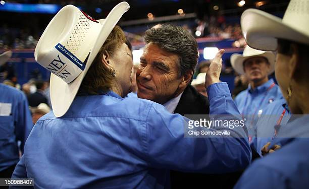 Rosemary Edwards of Austin Texas kisses the face of Texas Gov Rick Perry during the third day of the Republican National Convention at the Tampa Bay...