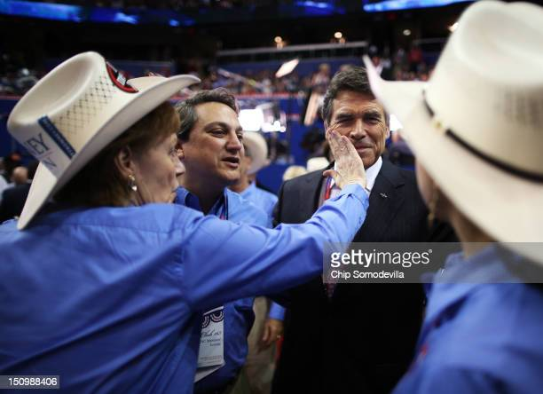 Rosemary Edwards of Austin Texas wipes the face of Texas Gov Rick Perry during the third day of the Republican National Convention at the Tampa Bay...