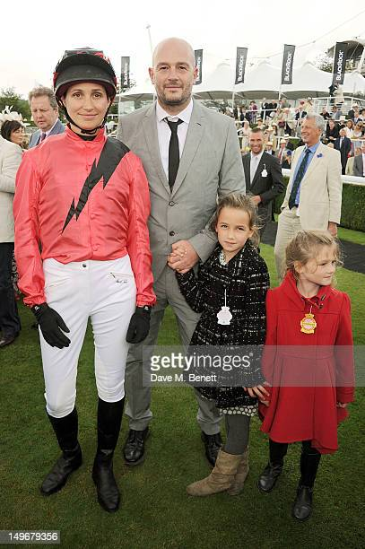 Rosemary Ferguson and Jake Chapman pose with their children during Ladies Day at Glorious Goodwood held at Goodwood Racecourse on August 2 2012 in...