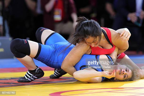 Rosemary Flores Curtis High School and Sarah Andresen Hunter College High School in action during a youth wrestling exhibition during the Beat the...