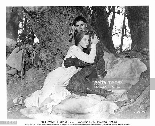 Rosemary Forsyth is held by Charlton Heston in a scene from the film 'The War Lord' 1965