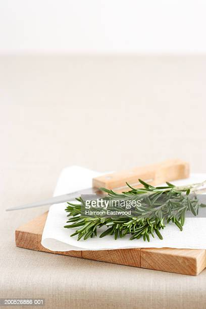 Rosemary herbs on chopping board