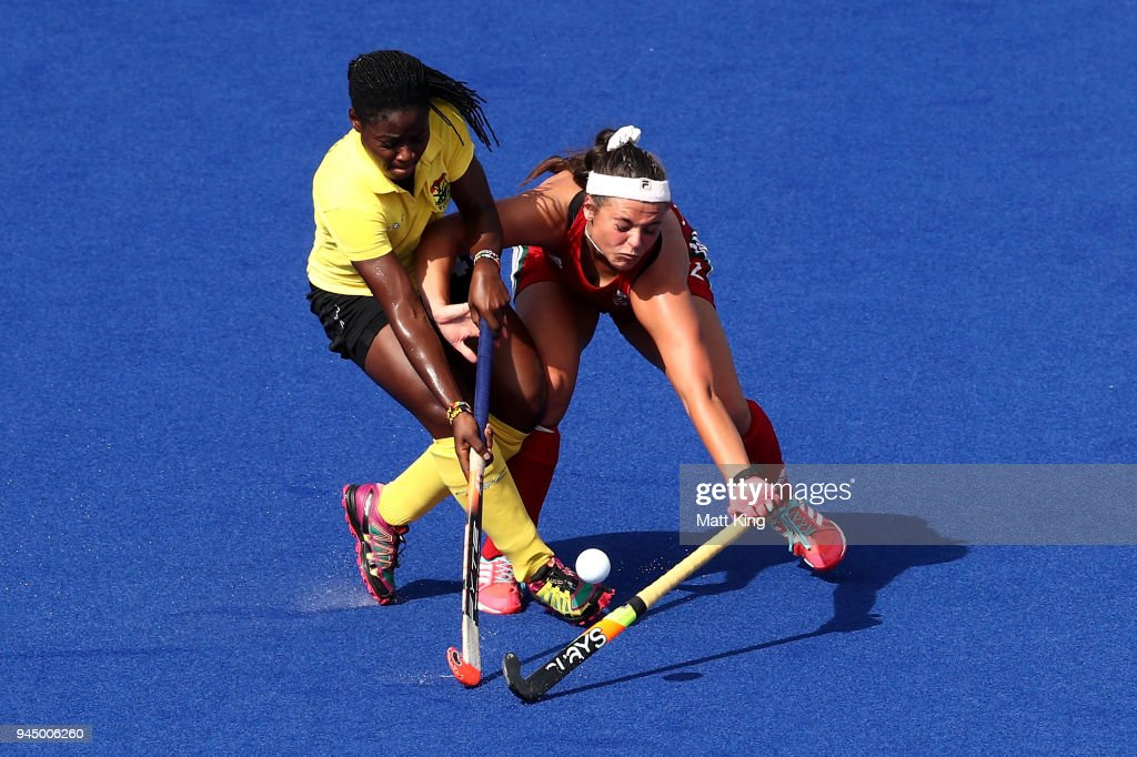 Rosemary Hulme of Wales is challenged by Mavis Berko of Ghana during Women's Placing 9-10 Hockey match between Wales and Ghana on day eight of the Gold Coast 2018 Commonwealth Games at Gold Coast Hockey Centre on April 12, 2018 on the Gold Coast, Australia.
