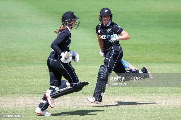 Rosemary Mair and Hayley Jensen of New Zealand run between the wickets during game one in the women's One Day International Series between Australia...