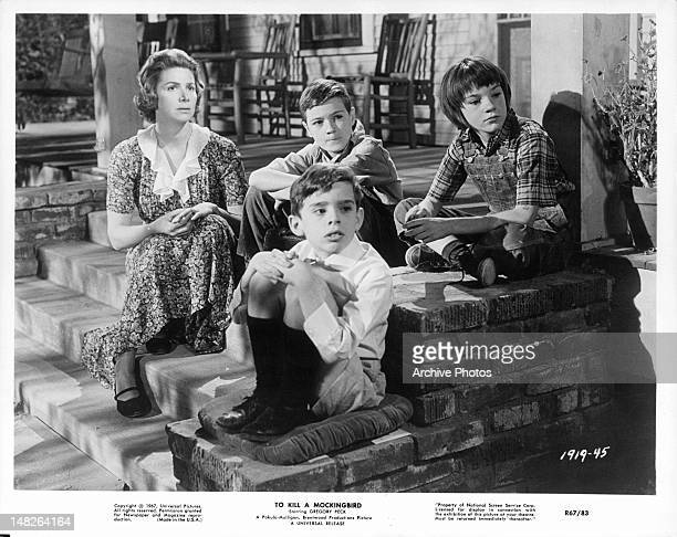 Rosemary Murphy sitting with Mary Badham Phillip Alford and John Megna in a scene from the film 'To Kill A Mockingbird' 1962