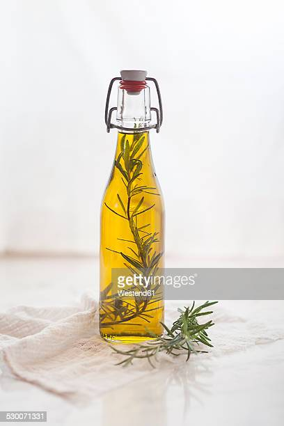 Rosemary oil, rosemary twig in olive oil