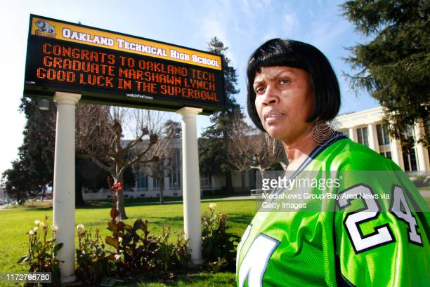 Rosemary Whisenton, mother of 49ers' Josh Johnson and aunt of Seattle Seahawks' Marshawn Lynch, poses for a photo near the school marquee with a...